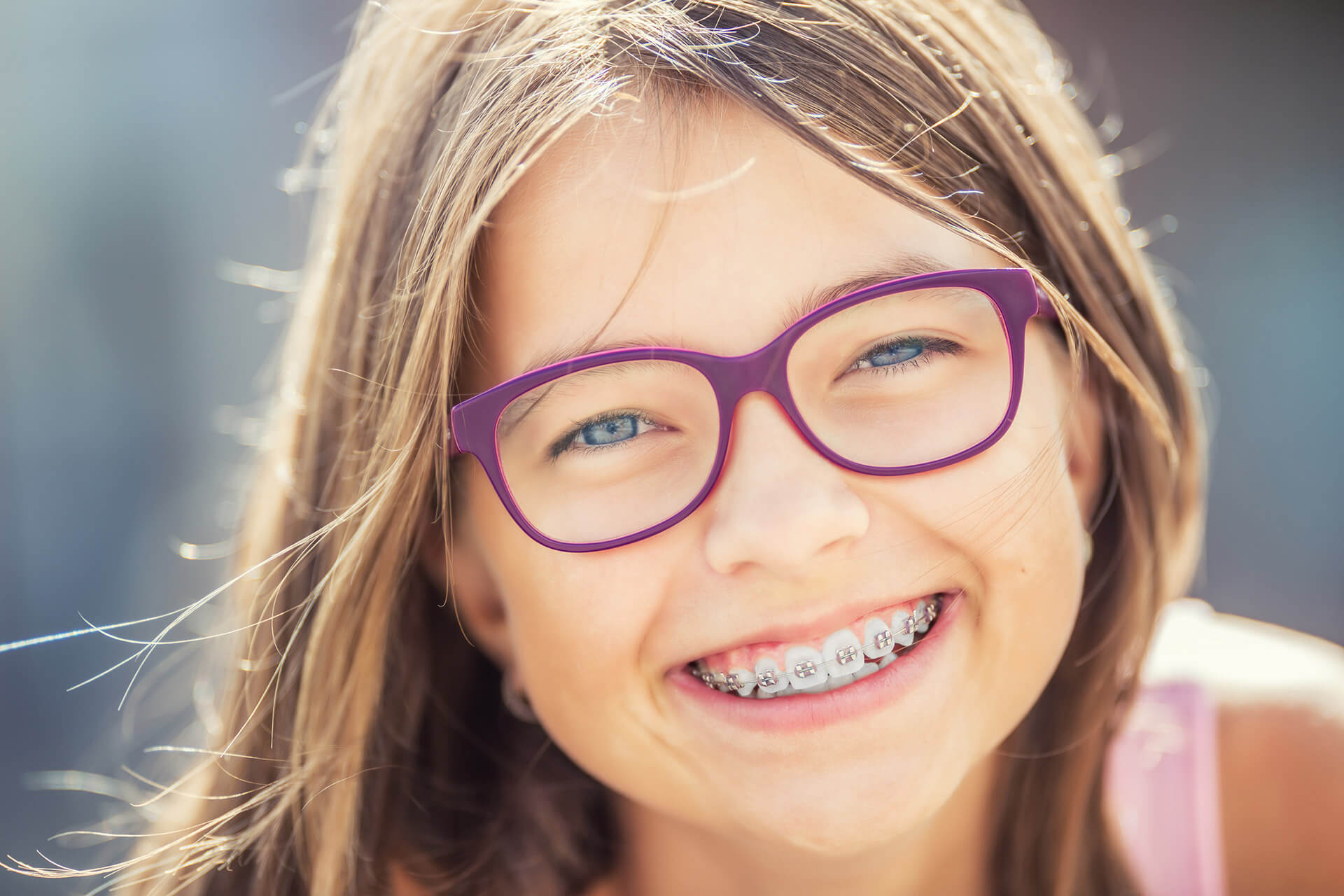 young girl with braces and glasses